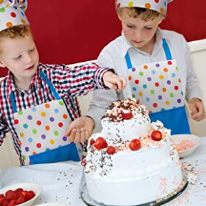 Young Boys Decorating Cake Wearing RiseBrite Polka Dot Aprons And Chef Hats
