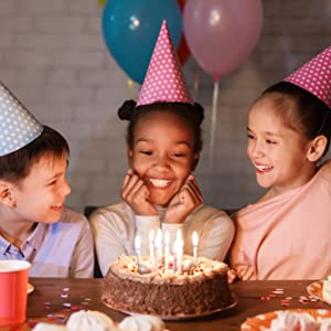 Girl Smiling Over Birthday Cake With Friends