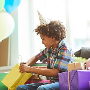 Boy Opening Up Birthday Gift