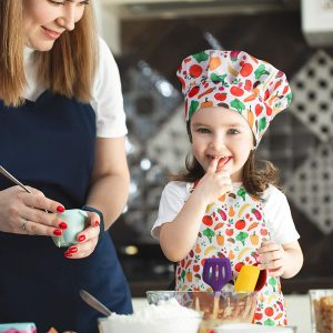 Young Girl Wearing Vegatable Print Apron And Chef Hat Included In RiseBrite Ultimate Real Kids Cooking Set