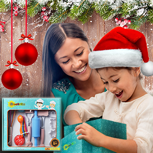 Girls Opening Present With Loving Mother At Christmas