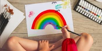 Girl Painting Rainbow Sitting On Floor