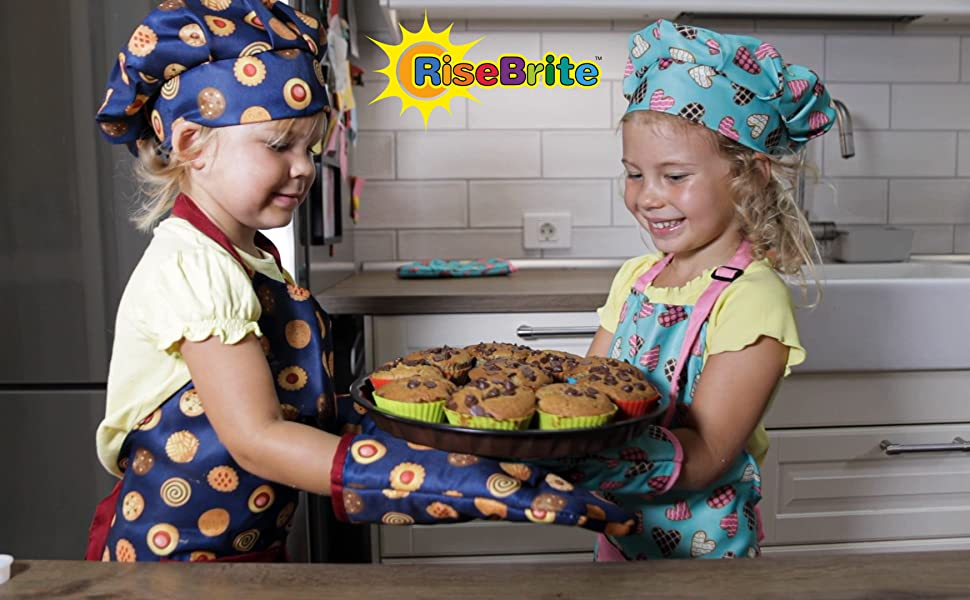 Girls In Cute Aprons Baking Muffins