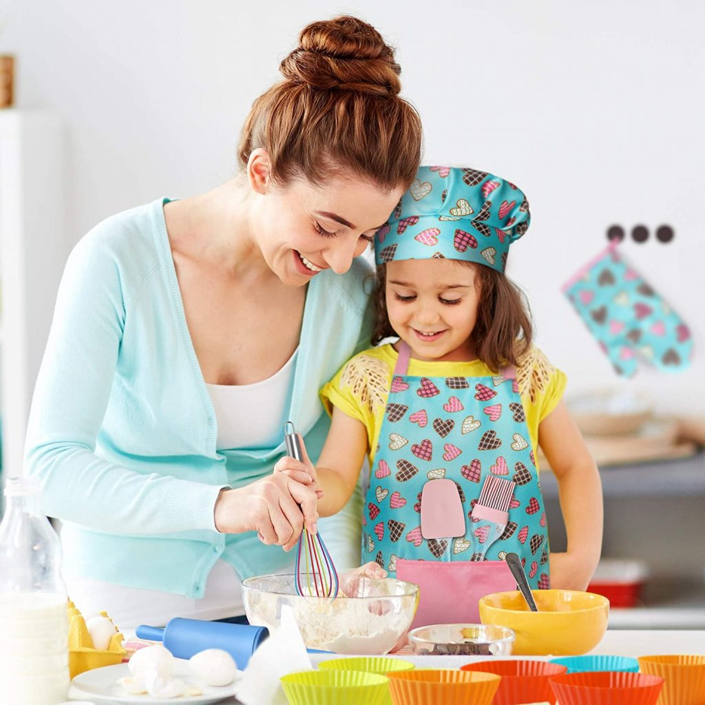 Girl Wearing RiseBrite Girls Pink Hearts Apron Baking With Mother