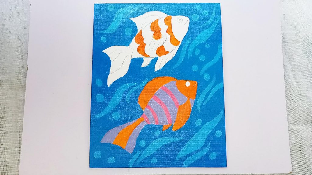 Simple, Cute, and Whimsical Underwater Fish Painting for Kids and Beginners Step 6: Add a Little Pink Acrylic Paint to the Lower Fish
